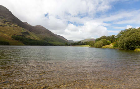 mere: Buttermere lake in Lake District in England looking down length of the water Stock Photo