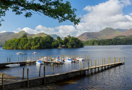 Piers and boats on edge of Derwentwater in English Lake District in early morning Stock Photo - 15388970