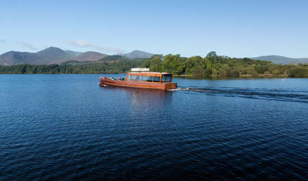 Boats on edge of Derwentwater in English Lake District in early morning Stock Photo - 15363420