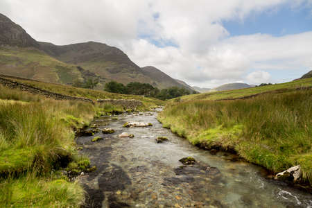 Rocky river leads to Buttermere over Honister Pass in English lake District Stock Photo - 15363442
