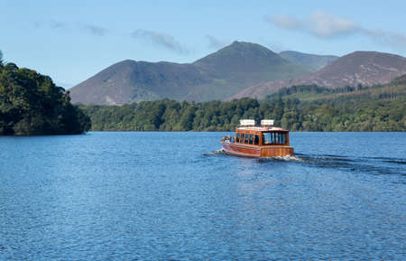 Boats on edge of Derwentwater in English Lake District in early morning Stock Photo - 15363330