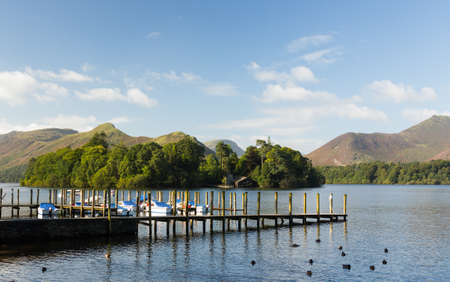 Piers and boats on edge of Derwentwater in English Lake District in early morning Stock Photo - 15388967