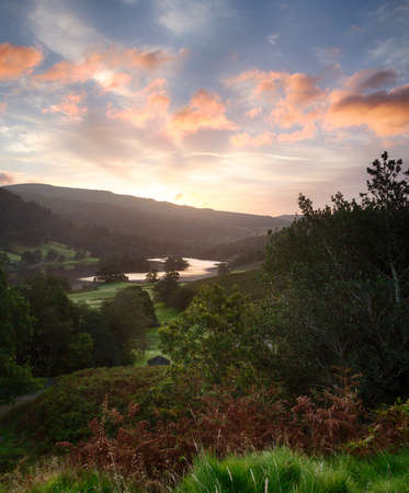cumbria: Sun rising over the mountains around Rydal Water in Lake District