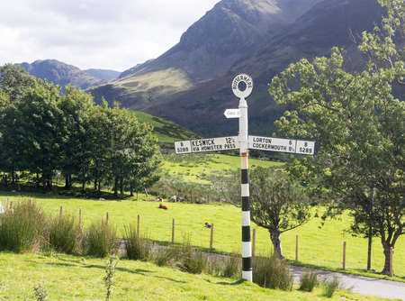 cumbria: Old signpost near Wrynose Pass in Lake District