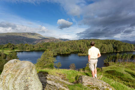 Senior hiker looks over Tarn Hows in English Lake District Stock Photo - 15369740