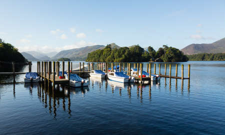Piers and boats on edge of Derwentwater in English Lake District in early morning Stock Photo - 15363424