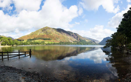 cumbria: Mountains reflect into Buttermere calm lake in English Lake District