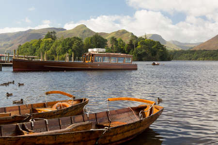 Piers and boats on edge of Derwentwater in English Lake District in early morning Stock Photo