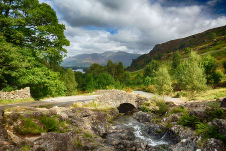 Traditional stone Ashness Bridge in English Lake District photo
