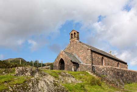 Stone church by side of road in Buttermere in English Lake District Stock Photo - 15363411