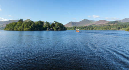 Piers and boats on edge of Derwentwater in English Lake District in early morning Stock Photo - 15363399