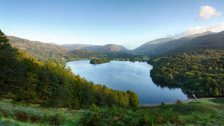 cumbria: Overlook of Grasmere in Lake District as sunrise as sun light mountains
