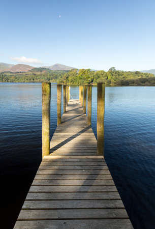 cumbria: Wooden Piers on edge of Derwentwater in English Lake District in early morning