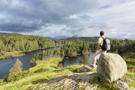 Senior hiker looks over Tarn Hows in English Lake District Stock Photo - 15367743