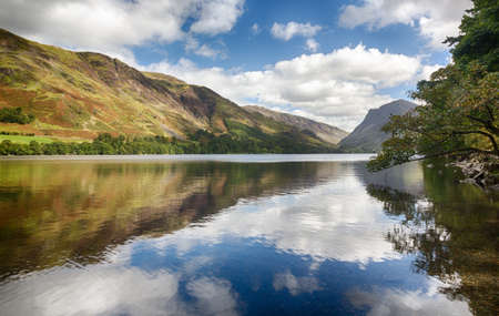 countryside landscape: Mountains reflect into Buttermere calm lake in English Lake District