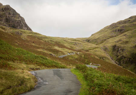 Steep hairpin bends on Handknott pass in English Lake District Stock Photo - 15363391