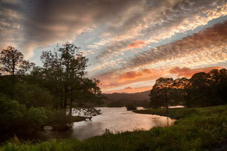 Setting sun illuminates clouds over Rydal Water in English Lake District Stock Photo - 15363386