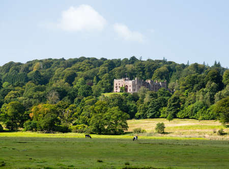 Muncaster Castle nestles in woodland on the edge of Lake District in England Stock Photo - 15347293
