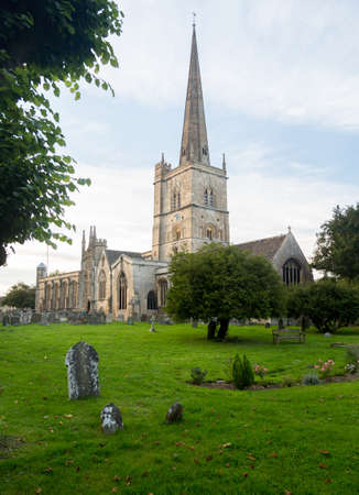 St John the Baptist Church and  graveyard in old Cotswold town of Burford photo