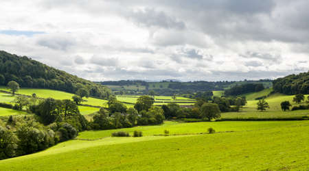 english countryside: Broad panorama of the countryside in North Wales with green field in foreground Stock Photo