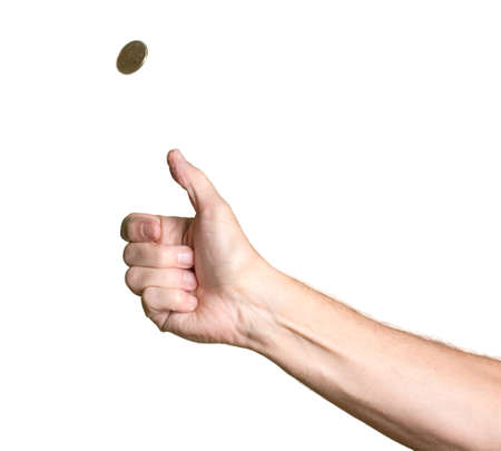 coin toss: Male bare arm with hand tossing a golden USA coin in the air and spinning towards heads