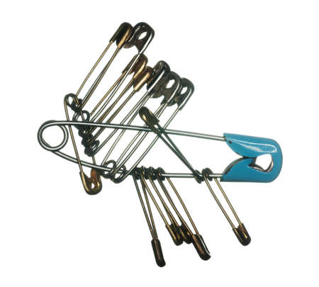 keywords link: Macro image of many safety pins for clothes making on white background Stock Photo