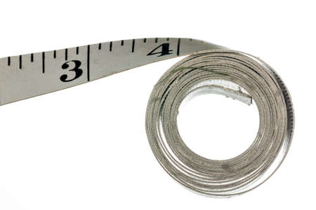 Measuring tape with inches made of cloth and isolated against white background Stock Photo