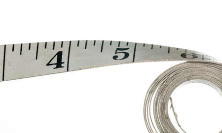 inches: Measuring tape with inches made of cloth and isolated against white background Stock Photo
