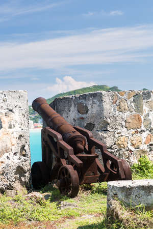 sint: Old rusting cannon at Fort Amsterdam overlooking Philipsburg Sint Maarten
