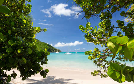 sint: Anse Marcel beach and boats on french side of St Martin Sint Maarten Caribbean