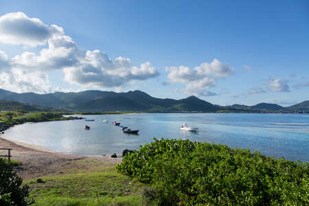 moored: View in St Martin at Baie de l Embouchure with boats moored in lines