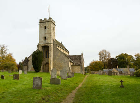 Parish Church of St Mary in Swinbrook Oxford. Nancy Mitford Author buried in graveyard Stock Photo - 16459838