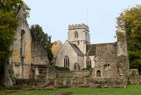 Church of Minster Lovell in Cotswold village with graveyard photo