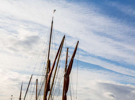 kent: Thames sailing ship or barge with masts and sails by dock in Faversham Kent UK