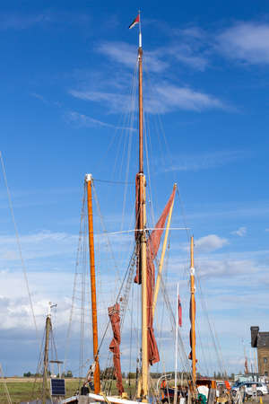 gaff: Thames sailing ship or barge with masts and sails by dock in Faversham Kent UK