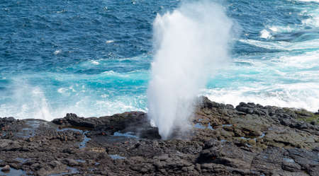 blow hole: Sea spout or blow hole on Suarez point in rocks on Espanola Galapagos Islands