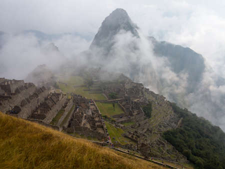 urubamba valley: Morning views of Machu Picchu as mist clears from the mountainside