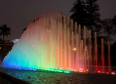 Illuminated fountains at dusk in Magical Water Circuit in Reserve Park, Lima, Peru world record for largest fountains
