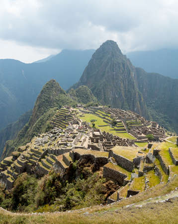 Morning views of Machu Picchu as mist clears from the mountainside photo