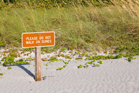 Please do not walk on dunes sign on beach in state park Key Biscayne Florida Stock Photo - 16999245
