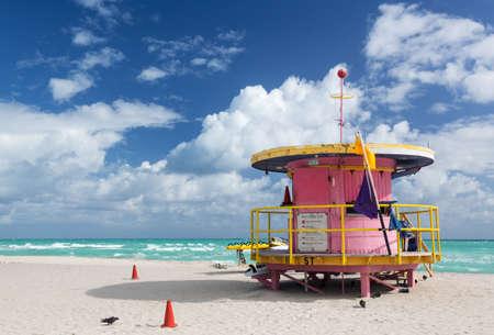 Circular round pink lifeguard station on Miami beach Florida photo