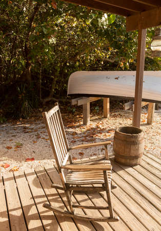 Rocking chair on porch of lighthouse keeper home at Cape Florida Bill Baggs State Park Stock Photo - 16999292