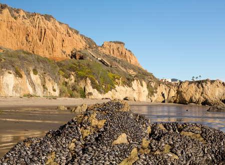 Rock formation by ocean on El Matador State Beach Malibu California 免版税图像