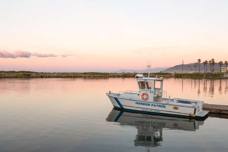 VENTURA, CALIFORNIA - 13 DECEMBER: Ventura Port District Harbor Patrol boat docks at dawn on 13 December 2012. The Harbor commenced operations in 1963.