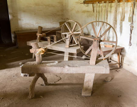 wheel spin: Old spinning wheel made from timber and branches in La Purisima mission California