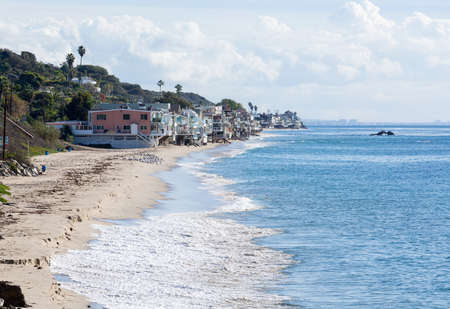 overhang: Modern houses overhang ocean and waves in Malibu California