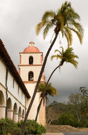 santa barbara: Mission Santa Barbara in California exterior on stormy day with clouds