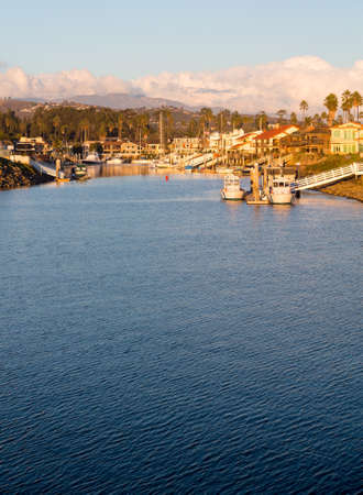 Sunset over residential development by water in Ventura California with modern homes and yachts boats Stock Photo - 17173664