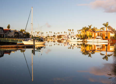 Residential development by water in Ventura California with modern homes and yachts boats photo