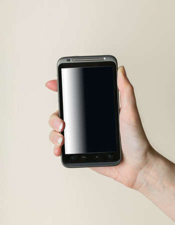 Female lady hand gripping black smartphone